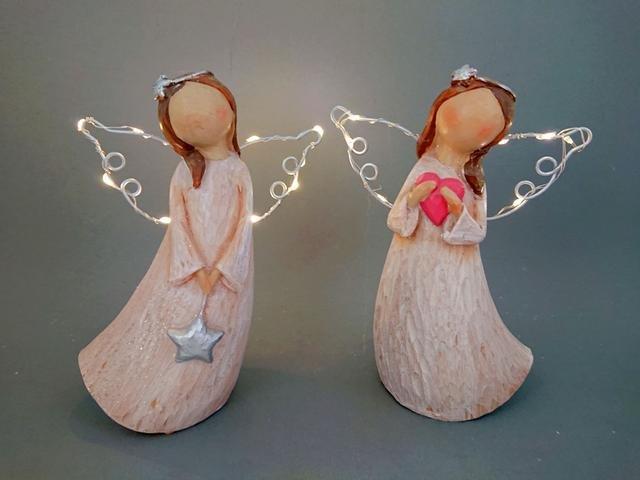 Anděl svítící křídla růžový